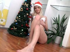 Nadi masturbates near her christmas tree