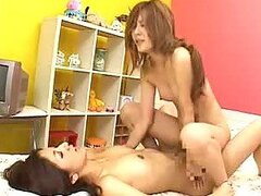 Asian Lesbian Babe Gets A Facial From Her Lover's Strapon Dildo