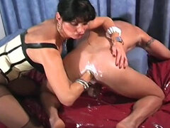 Mistress shoves huge dildo and fist up his ass