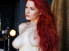 Lovely redhead with big naturals
