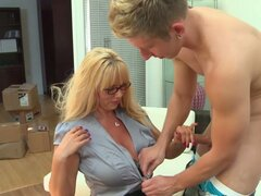 Blonde aunty Karen Fisher with big boobs sucking Danny Wylde's cock and getting thrusted doggystyle