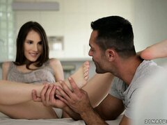 Tina has some talented feet and gets them licked before giving a footjob