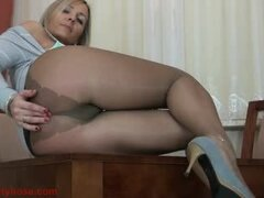 Mature blonde shows off beautiful treasures