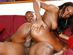 A pretty ebony jumps on top of her man's member and takes it real deep
