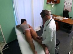 Horny doctor fingering his sexy patients pussy