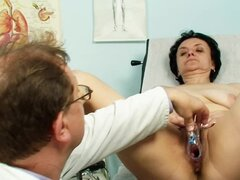 Doctor looks at mature pussy