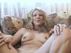Full figured curvy blonde housewife shows off her curves on couch