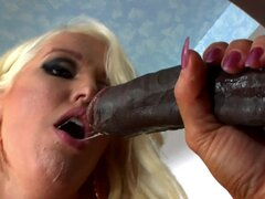 Busty blonde wearing stockings gets fucked by black guy