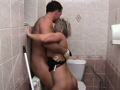 Guy in yellow rubber gloves is humping cute lady in restroom