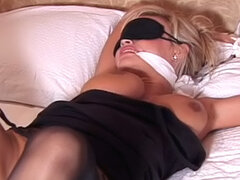 Tied blonde gets nice dose of spanking!