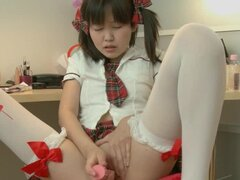 Adorable Asian schoolgirl pleases her own pussy