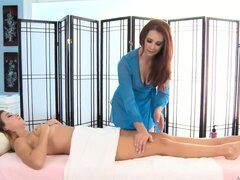 All girl massage scene with a hot babe using a strapon to fuck her friend