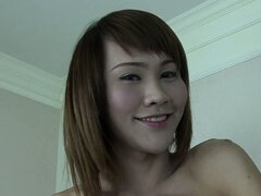 Skinny ladyboy June has got a yummy nice-sized gift hiding...