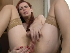 Cute redhead babe Mystique stretches her pussy