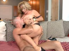 Horny momma Kandi Cox exposes her big assets in front og young guy