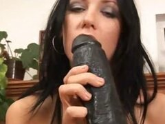 Marty pounds her euro pussy with a huge dildo