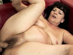 He's pounding his granny girlfriend hard...