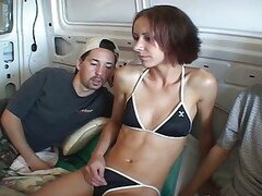 Skinny redhead banged on the back of a van