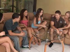 Teen girls playing strip poker with boys