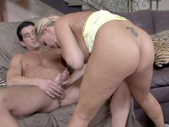 Mature slut Maya Divine is giving a blowjob in her living room