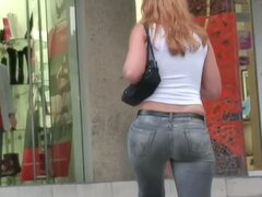 Awesome hussy in black jeans has a very big athletic butt