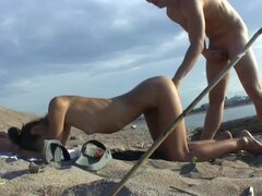 Hot amateur sex on the beach with a slim babe