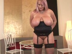 Big-titted blonde Laura Orsolya penetrates her shaved puss