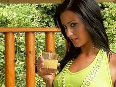 Busty brunette in green dress drinks juice and gets boobs squeezed