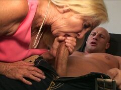 Hot granny gets a hard cock in her moist mouth