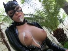 Catwoman in skintight latex drinks milf in the backyard