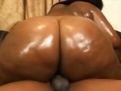 Black fatty rides a dick on the couch