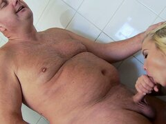 Old dude gets lucky with a horny blonde who blows him and humps