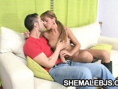 Shemale Latina Melina's cock is rock hard as she sucks another cock in her mouth.