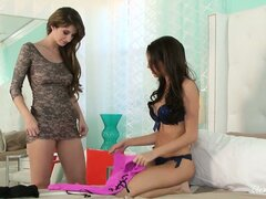 Brunette duo shares sexy clothes and hot lesbian girl on girl action