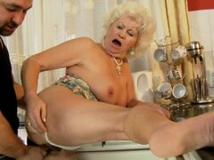 Effie gets her old pussy fucked from behind in the kitchen