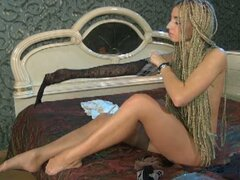 Hot braided hair slut loves to try her stockings