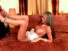 Slender blonde Nessa Devil is making a footjob