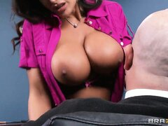 Babe with a nice rack of brown tits gives her boss a blowjob