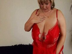 Chubby mature mom with big tits is toying