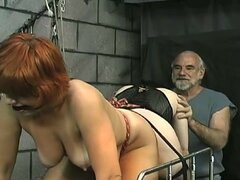 Redhead babe being humiliated in BDSM video