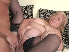 Blonde granny Dominicka moans loudly while getting her pussy drilled