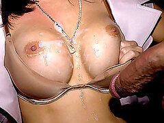 A girl gets her tits covered with cum at the sex party