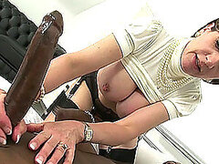 Nasty milf gives a blowjob to an enormous black cock