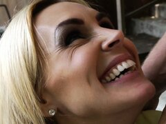 Dazzling blonde milf Tanya Tate reveals her huge tits and her passion for big cock