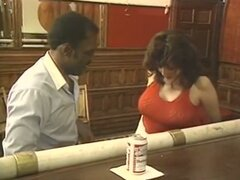 Busty brunette eats black cock and jacks him off in classic porn