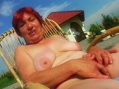 Mature redhead with fat tits fucked outdoors