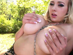 Blonde Sapphire takes off her leather bra