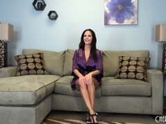 Busty brunette hottie Ava Addams gets a live interview and poses