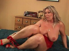 Older woman with natural big tits...