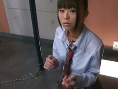 Japanese schoolgirl Chika is on her knees chained to a pole...